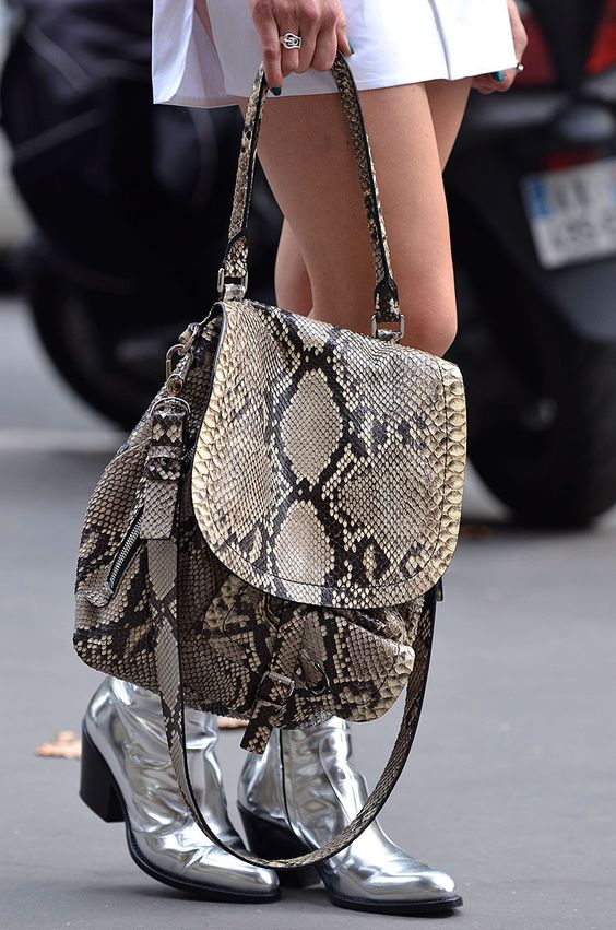 a snake leather backpack will add a chic and bold touch to the outfit and will provide much stuff