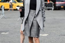 06 a stylish office look with a black top, a grey oversized blazer, a grey printed skirt, snake print shoes