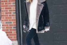06 a white oversized sweater, black skinnies, black belted combat boots and a black and taupe aviator jacket