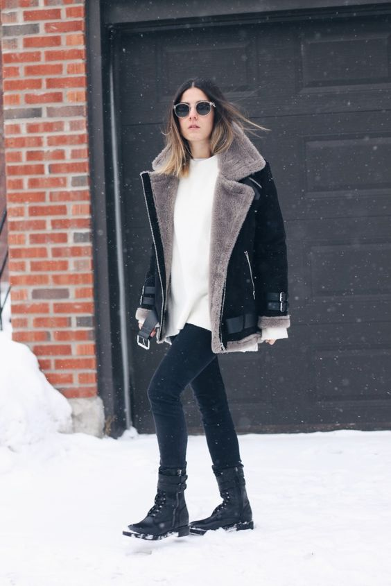 a white oversized sweater, black skinnies, black belted combat boots and a black and taupe aviator jacket
