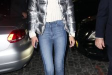 07 Gigi Hadid wearing blue cropped skinnies, grey boots, a white cropped sweater and a silver padded jacket