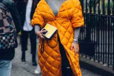 07 a bright marigold quilted coat makes a statement with its color and it very trendy for now