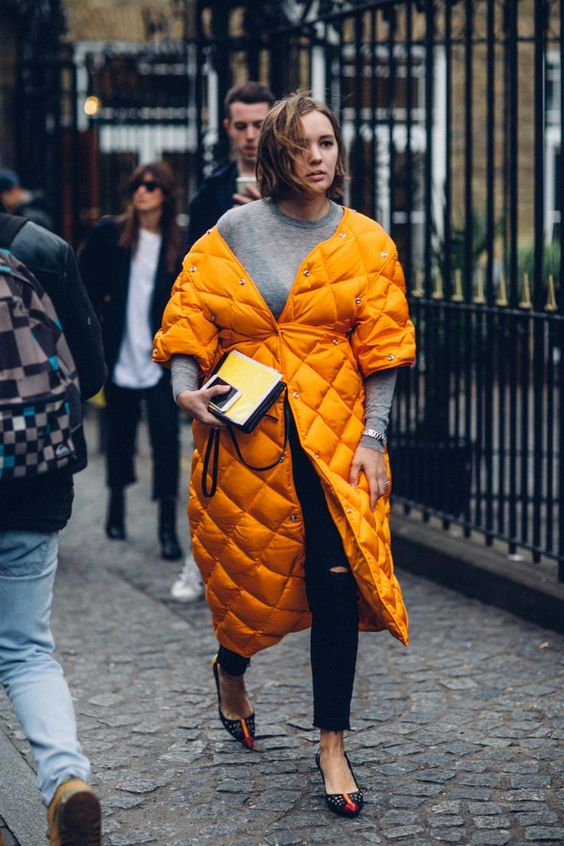 a bright marigold quilted coat makes a statement with its color and it very trendy for now