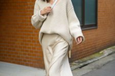 07 a minimalist  monochromatic outfit with a creamy slip midi dress, a ribbed oversized pullover and white sneakers and a bag