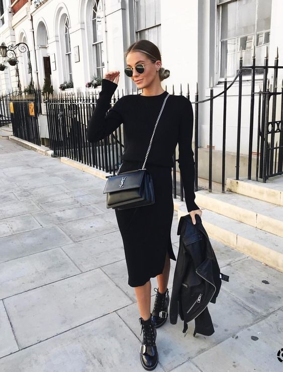a sleek black dress with long sleeves, a black leather jacket, combat boots and a bag are a cool look to steal right now