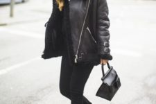 07 a total black look with a top, skinnies, belted and buckle boots, an aviator jacket and a beanie