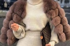 08 a creamy knit suit with a turtleneck sweater, a mauve faux fur cropped coat, a brown clutch