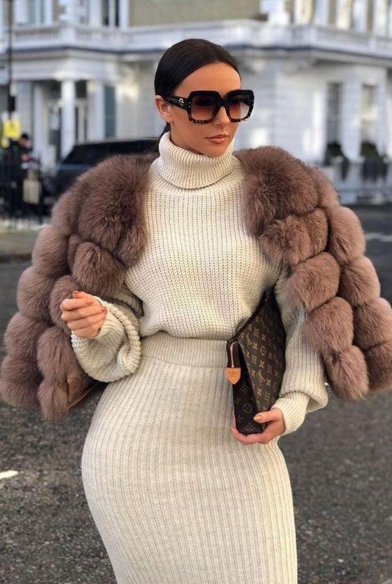 a creamy knit suit with a turtleneck sweater, a mauve faux fur cropped coat, a brown clutch