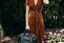 08 a rust-colored velvet wrap midi dress, black heels and a black bag for a fall-colored Thanksgiving look