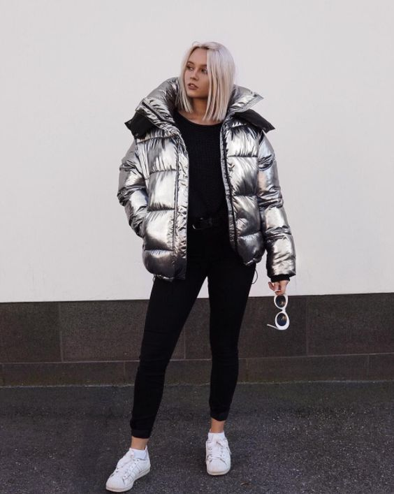 a simple and stylish look with a black jumper, skinnies, white sneakers and a silver puffer jacket