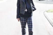 09 a black sweatshirt, dark plaid pants, black combat boots, a black leather jacket and a bold beanie