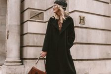 09 a cozy winter outfit with a brown printed midi dress, a black wrap midi coat, blakc boots and a beanie