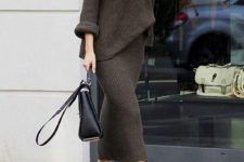 09 a dark brown knit suit with a slouchy long sleeve top and a midi pencil skirt, black boots and a black bag for work