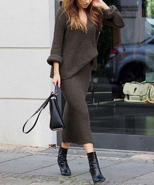 a dark brown knit suit with a slouchy long sleeve top and a midi pencil skirt, black boots and a black bag for work
