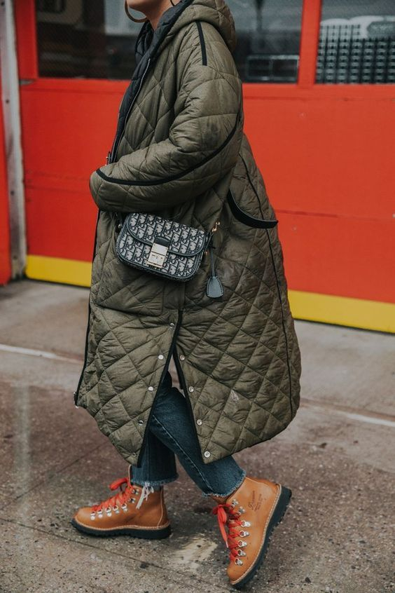 a dark green quilted midi coat with buttons and black edging is a stylish idea for the fall or winter