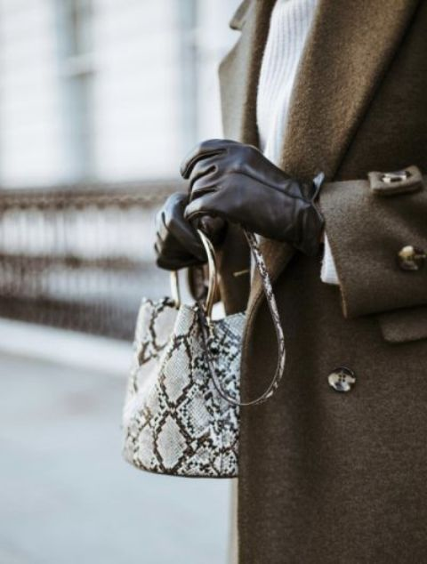 a mini bucket snake leather bag with large ring handles is a refined and chic piece to try