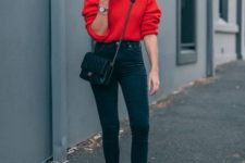 09 a red jumper, black high waist skinnies, black sneakers and a small black bag
