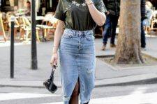 09 a rock-inspired look with an embroidered tee, a blue denim midi with a slit, black booties and a black bag