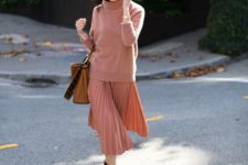 09 an oversized coral sweater, a matching pleated midi and brown velvet shoes plus an amber bag