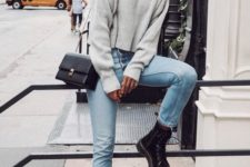 10 a grey cropped sweater, blue jeans, black combat boots and a black bag for fall and winter