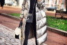 10 a modern and chic look with a black sweater, cropped pants, black and metallic booties and a silver padded coat