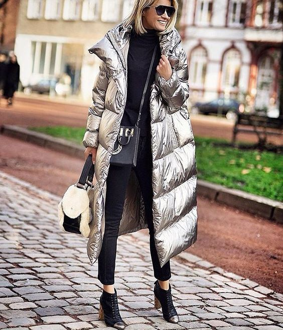 a modern and chic look with a black sweater, cropped pants, black and metallic booties and a silver padded coat