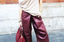 10 a neutral cashmere sweater, burgundy leather culottes, nude shoes and a red bag for work