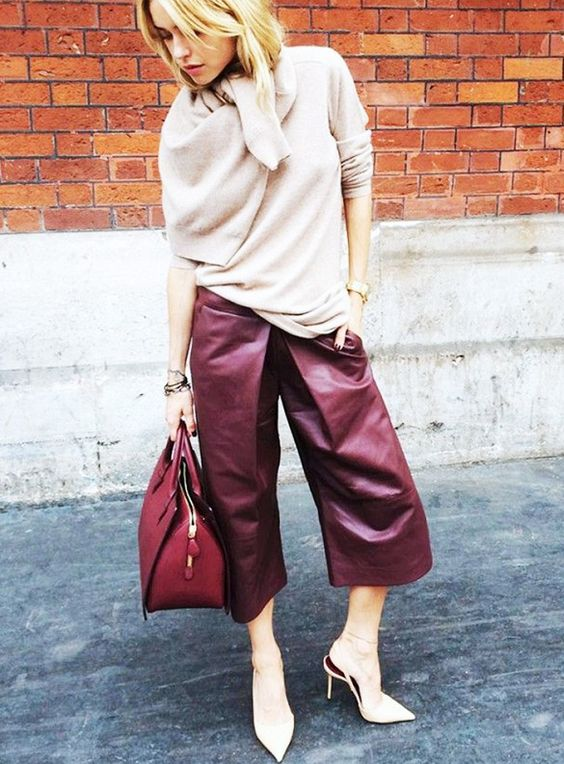 a neutral cashmere sweater, burgundy leather culottes, nude shoes and a red bag for work