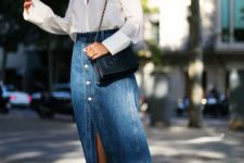 10 a romantic outfit with a white blouse, a blue denim midi on buttons, two tone shoes and a black bag