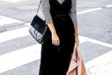 10 a striped long sleeve top, a black velvet slip dress, a black bag and black studded boots plsu a blush leather jacket