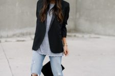 11 a black oversized blazer, a long dotted tee, blue ripped jeans, black sock boots and a beanie