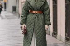 11 a green quilted coat with a brown leather belt and an animal print head cover are two trends in one outfit