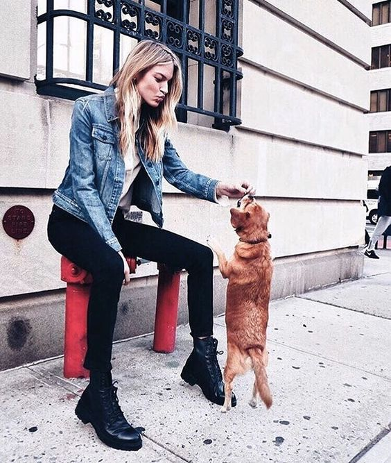 a grey top, a blue denim jacket, black skinnies, black combat boots are a great look to wear right now