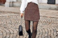 11 a white angora jumper, a tweed mini skirt, black boots and a black bag for a unique outfit