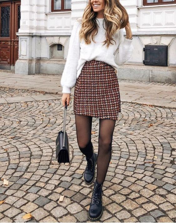 a white angora jumper, a tweed mini skirt, black boots and a black bag for a unique outfit