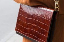 11 an elegant red and brown crocodile leather bag with a rigid design is a statement idea