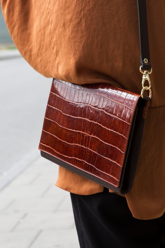 an elegant red and brown crocodile leather bag with a rigid design is a statement idea