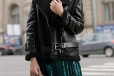12 a black sweater, an emerald pleated midi skirt and a black aviator coat plus a whimsy studded bag