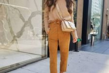 12 a casual outfit with mustard cropped pants, a tan sweater, creamy booties and a matching bag