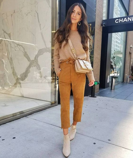 a casual outfit with mustard cropped pants, a tan sweater, creamy booties and a matching bag