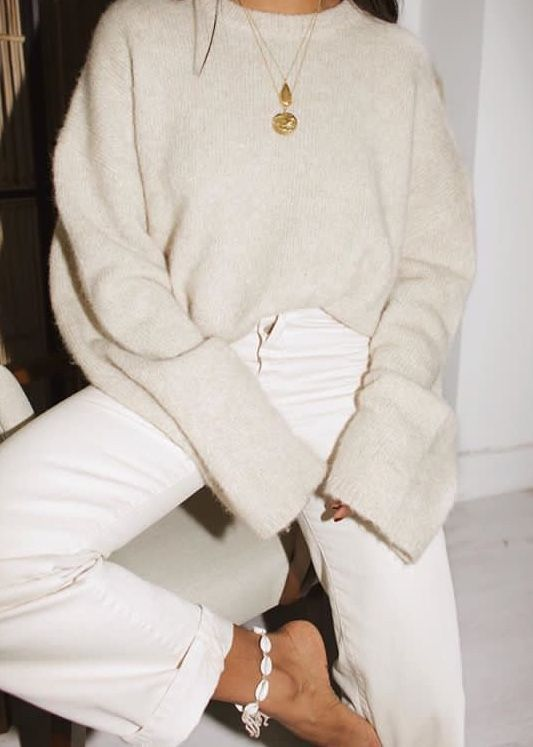 a monochromatic outfit with straight white jeans, a creamy oversized jumper and a statement necklace