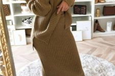 12 a pistachio-colored knit suit with an oversized one shoulder sweater and a midi skirt plus white shoes