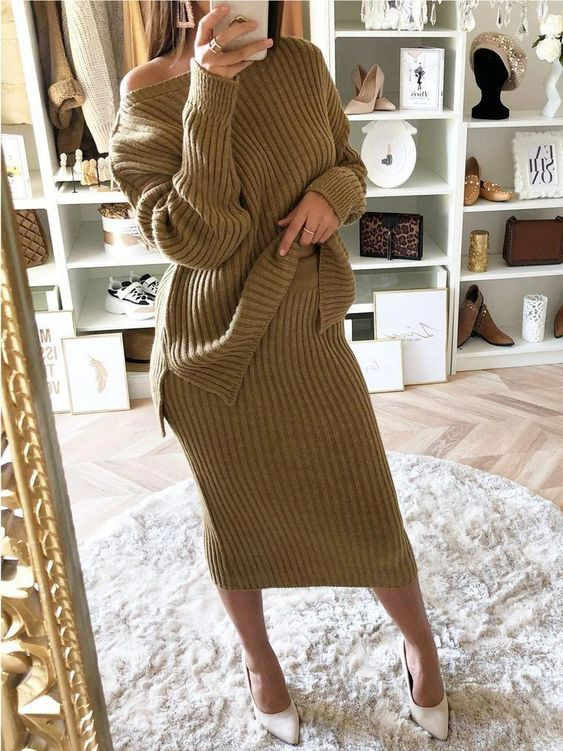 a pistachio-colored knit suit with an oversized one shoulder sweater and a midi skirt plus white shoes