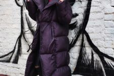 12 a trendy and bold look with colorful boots, a black blanket padded coat, a grey beanie