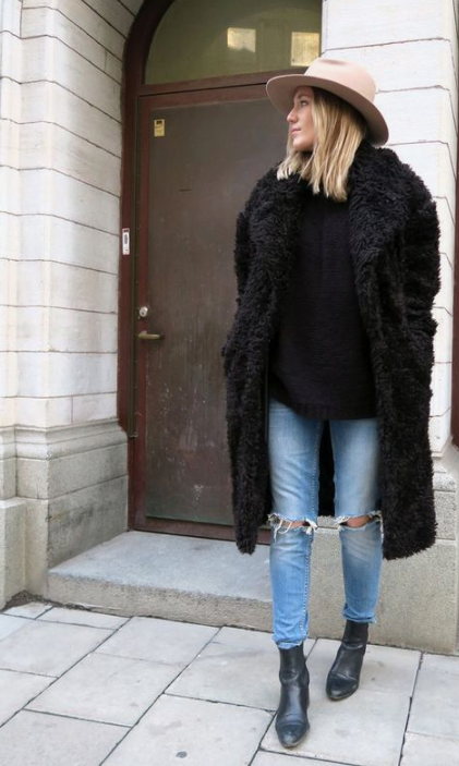 a bold outfit with a black faux fur coat and a blush fedora hat is a stylish option for winter