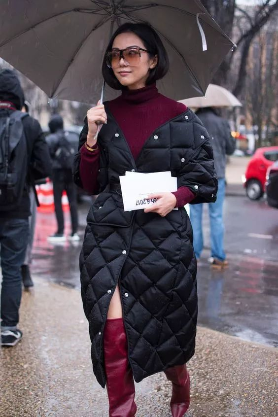 a navy quilted coat paired with burgundy looks very elegant and chic calming down the outfit