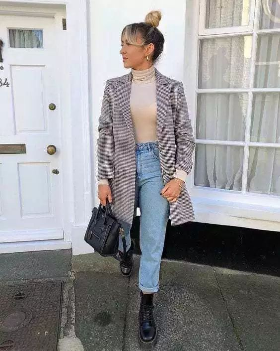 a nude turtleneck, blue straight jeans, black combat boots and an oversized printed blazer will make you look super trendy