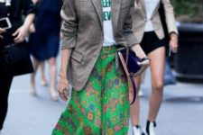 13 a printed tee, a bright printed green midi, white slip mules and a plaid oversized blazer