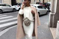 13 a pure white knit suit with a midi pencil skirt, white trainers, a creamy coat and a snake print bag