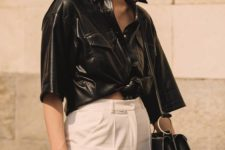 13 a trendy minimalist look with a black leather shirt, white wideleg pants, a black bag